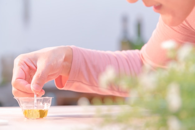Women hand put pregnancy test pad to urine