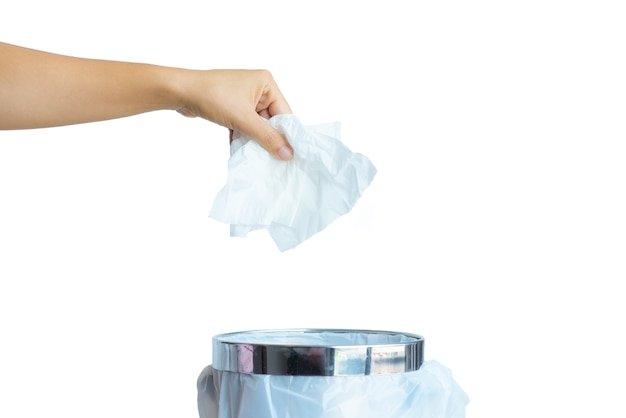 Women hand throwing white tissue paper in to a trash bin on white background.
