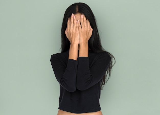 Women hands covering face studio