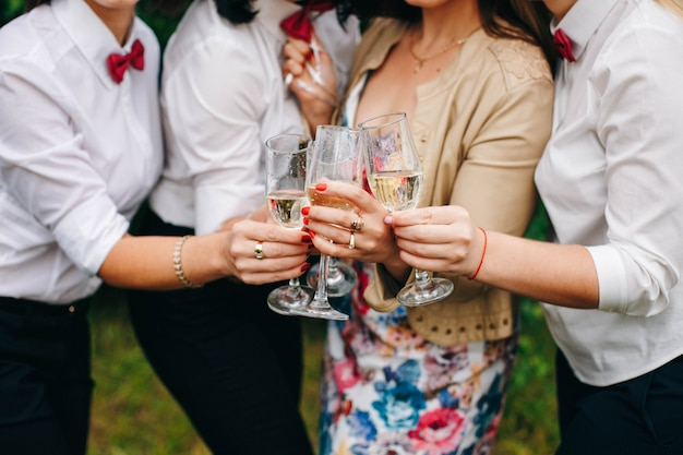 Women hands and glasses of champagne. celebrate a hen party.