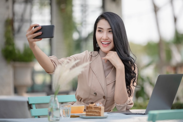 Women happy smiling video call on smartphone with friend