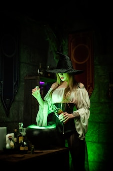 The women in a hat in the witch's room on halloween