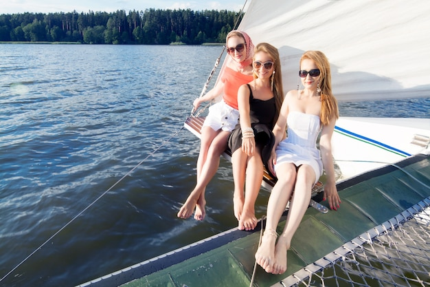 Women having fun on a yacht in the summer