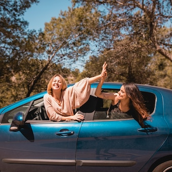 Women high-fiving in car