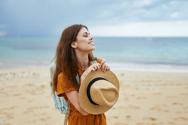 Women hiker backpack travel beach sand horizon landscape
