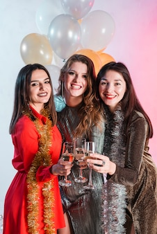 Women holding champagne glasses in hands