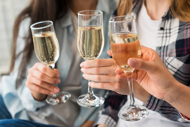 Women holding champagne glasses for toast