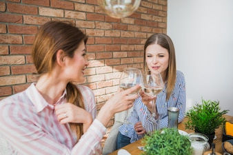 Women holding glasses and toasting