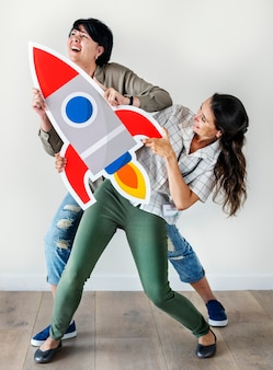 Women holding rocket icon