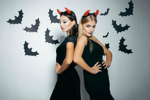 Women in horns celebrating halloween