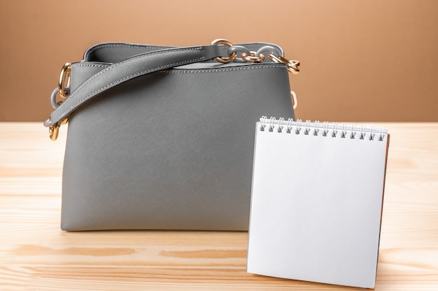 Women leather grey handbag and notepad. womens bag and notepad for writing.
