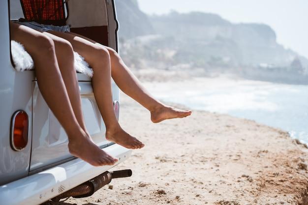 Women legs at retro van
