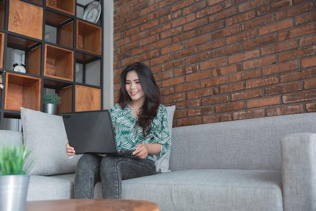Women lifestyle using laptop while sitting