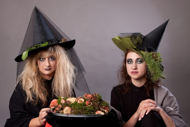 Women make up as witches for halloween