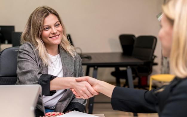 Women making a deal at work