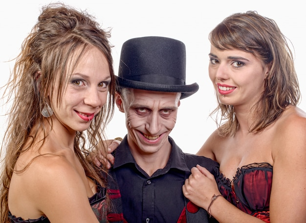 Women and a man in disguise vampire