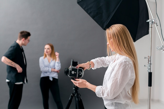 Women and man working in a photography studio