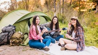 Women near tent looking at camera