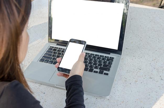 Women phones and laptop