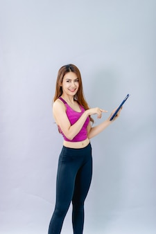 Women play ipad and smile happily with online communication. the concept of 5g online communication