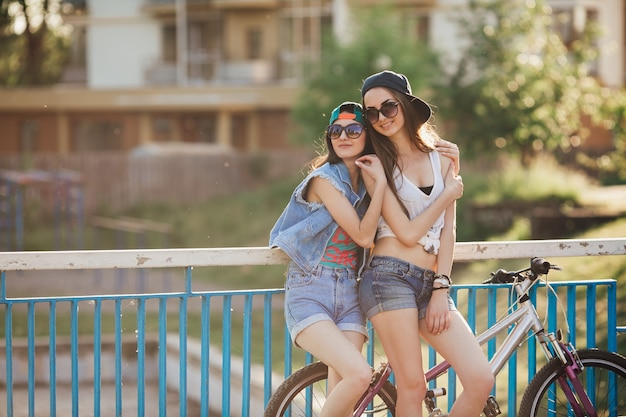 Women posing at handrail