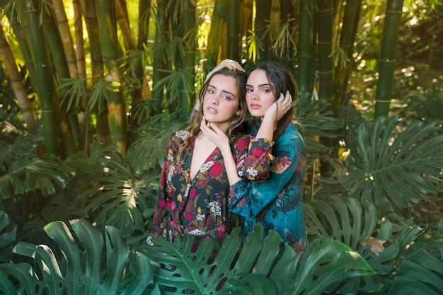 Women posing in a natural environment