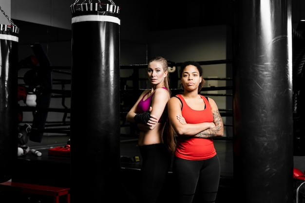 Women posing together in boxing training center