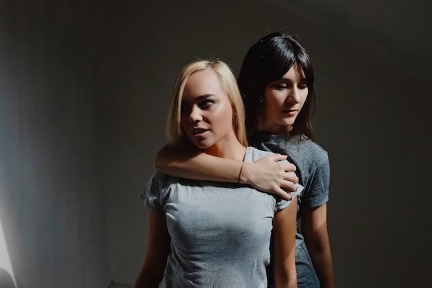 Women posing on wall