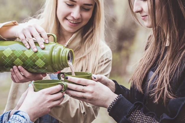 Women pour hot cocoa