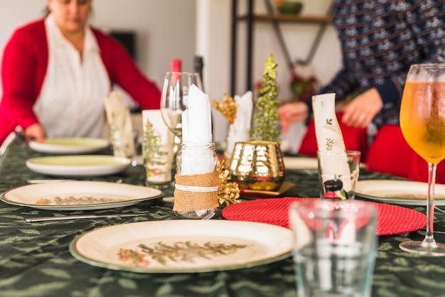 Women preparing festive table