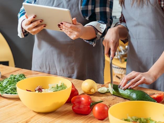 Women preparing healthy food in kitchen