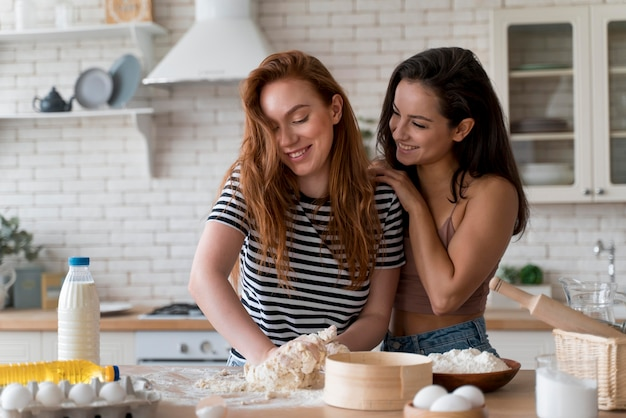 Women preparing together a romantic dinner at home
