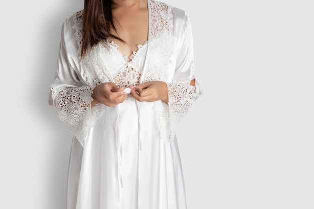 Women put on white sexy nightgown & long sleeve satin robe with floral lace