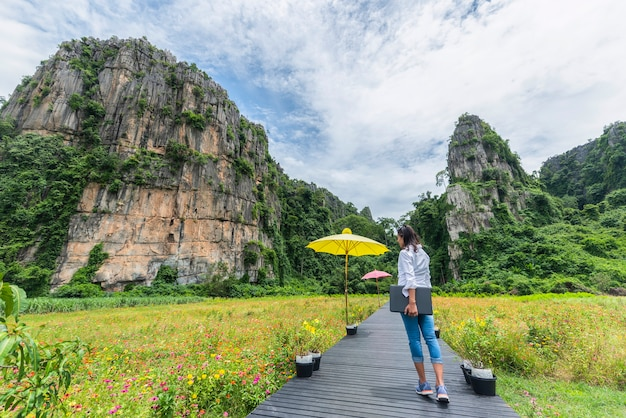 Women relaxed and enjoying the nature at noen maprang of phitsanulok district