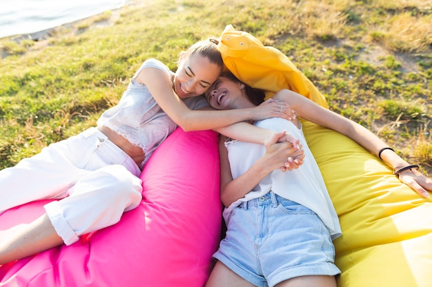 Women relaxing on colorful beanbags