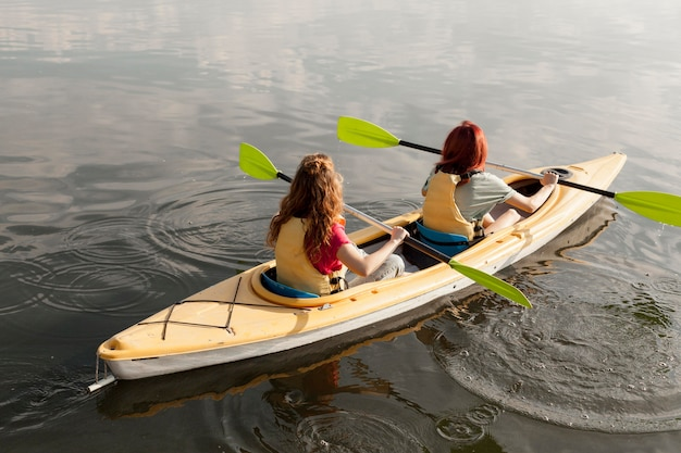 Women rowing in kayak