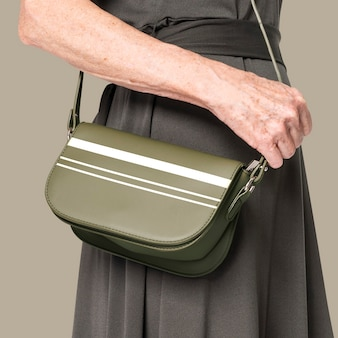 Women's green leather crossbody bag with stripes close up