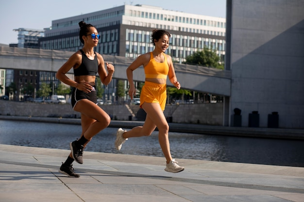 Women running together full shot