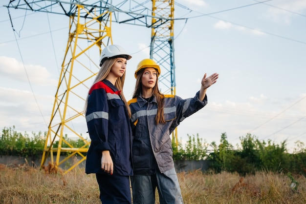 Women's collective of energy workers conducts an inspection of equipment and power lines