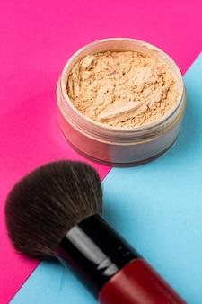 Women's cosmetic powder with brush