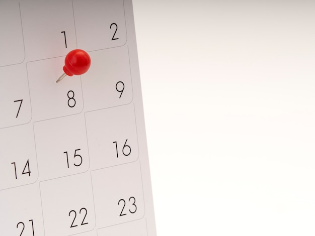 Women's day on calendar with red pin.