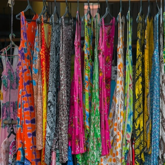 Women's dresses are sold on the street.