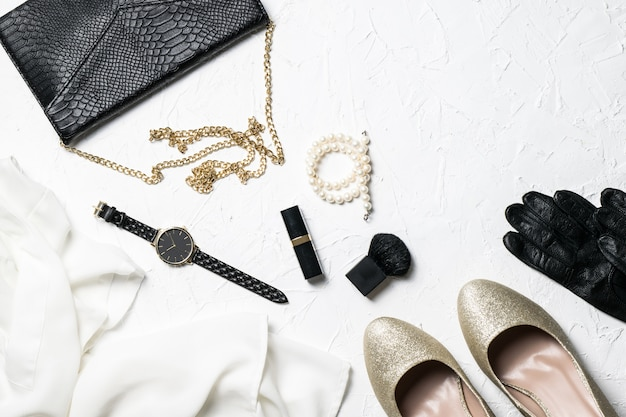 Women's fashion outfit and accessory flatlay