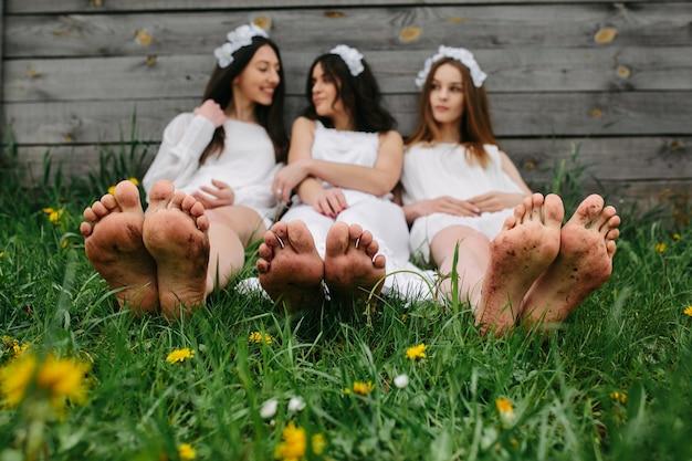Women's feet on the grass