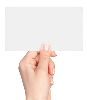 Women's fingers holding a blank business card isolated on white
