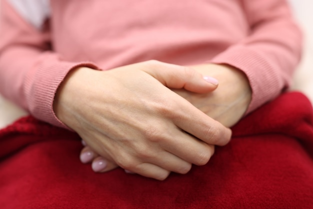 Women's hands are folded together. feminine serenity and self-confidence concept