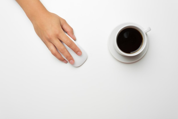 Women's hands, coffee and mouse