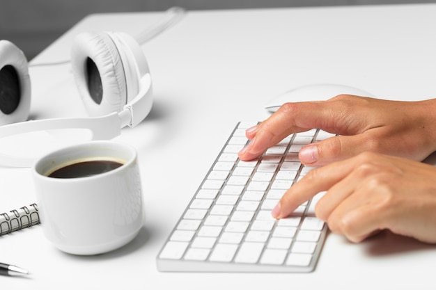 Women's hands using keyboard and mouse