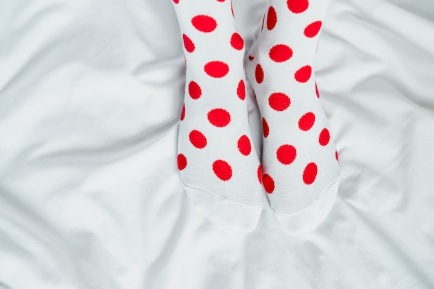 Women's legs in socks colors alternating