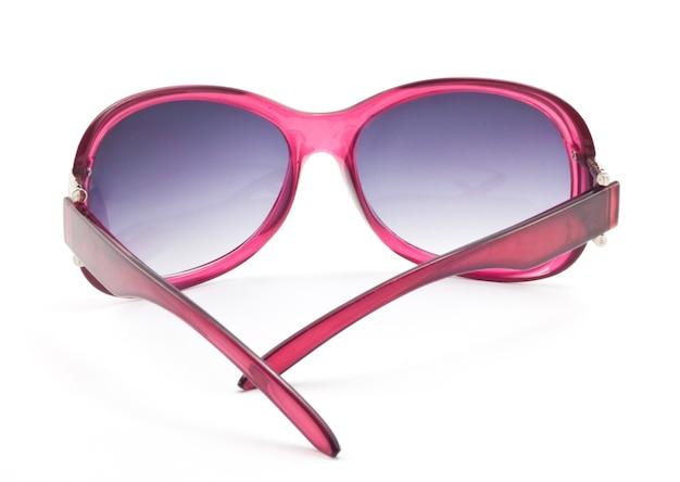 分離された女性のピンクのサングラス